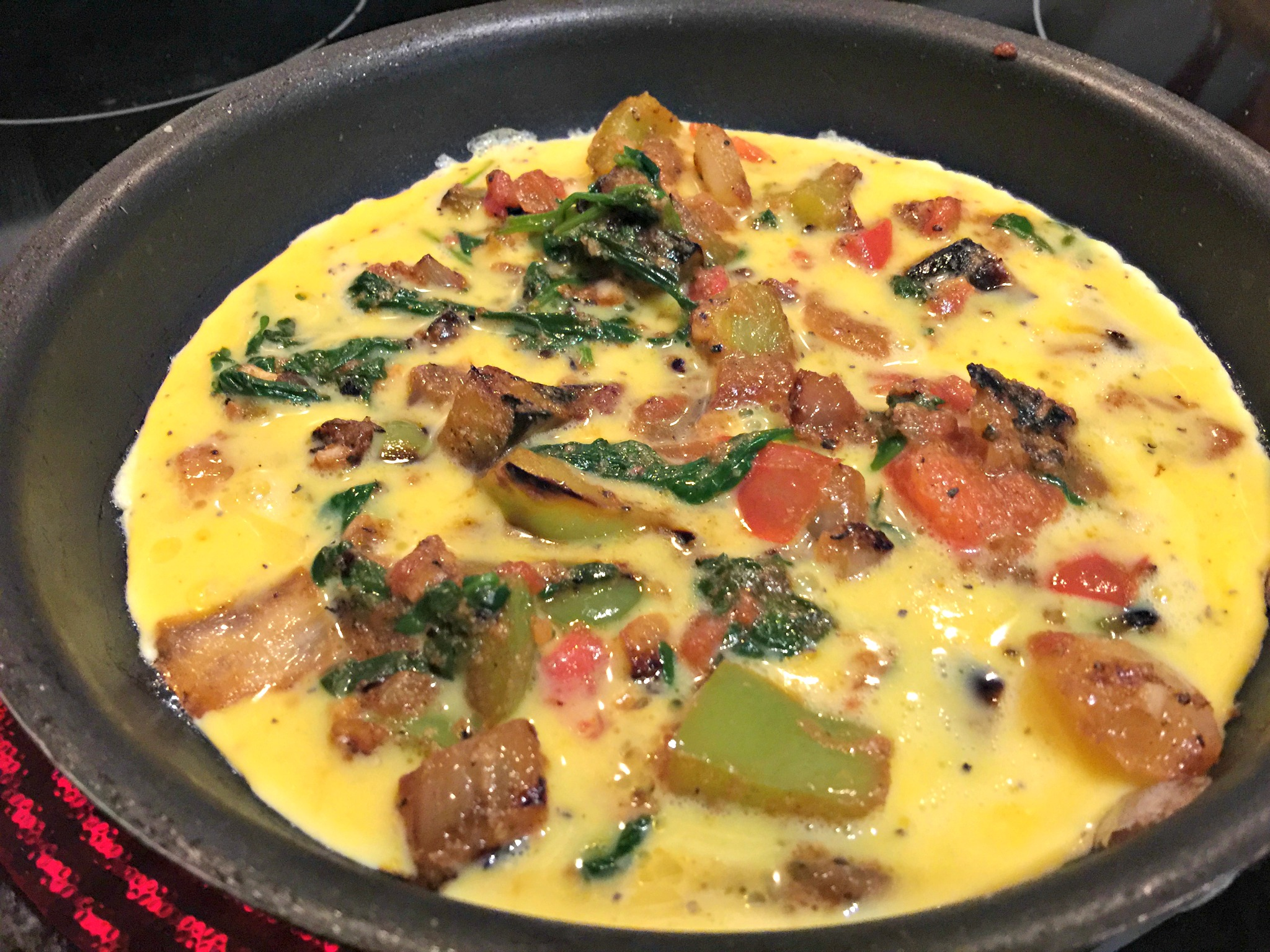 Vegetable Omelet: Sautéed Onions, Tomatoes, Spinach, Bell Peppers with Pepperjack Cheese.