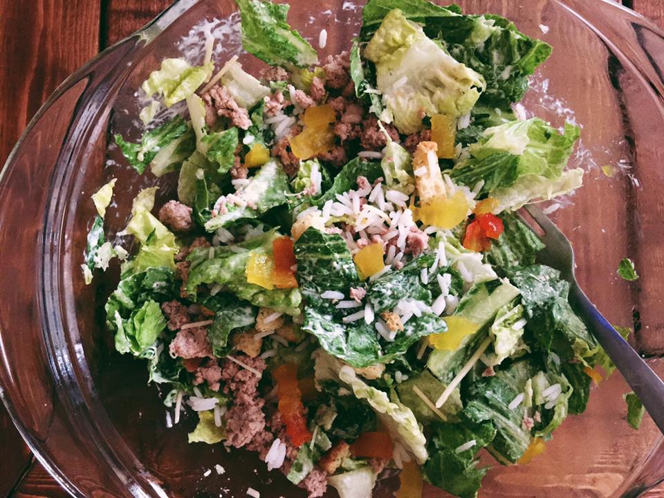 salad with ground turkey, asiago cheese, white rice, romaine, dressing, croutons, and banana peppers,