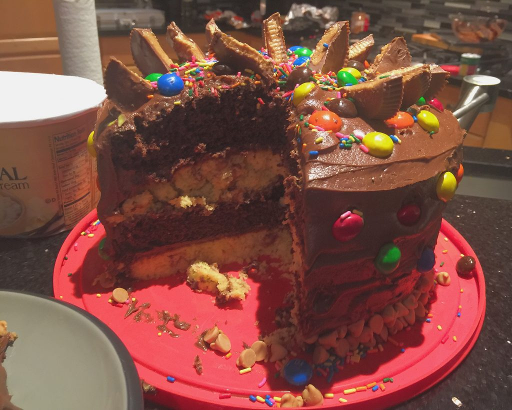 Ultimate Four Layered Peanut Butter Chocolate Fudge Cake