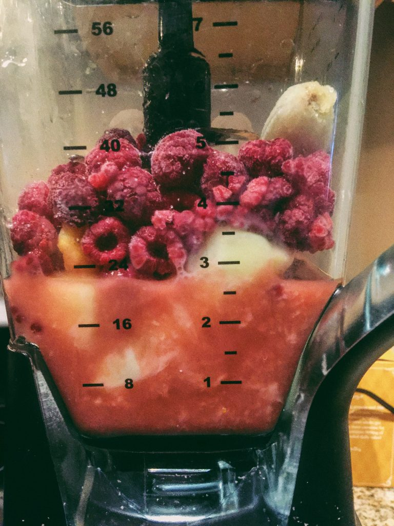Raspberry, pineapple, peach, lemon, and banana smoothie