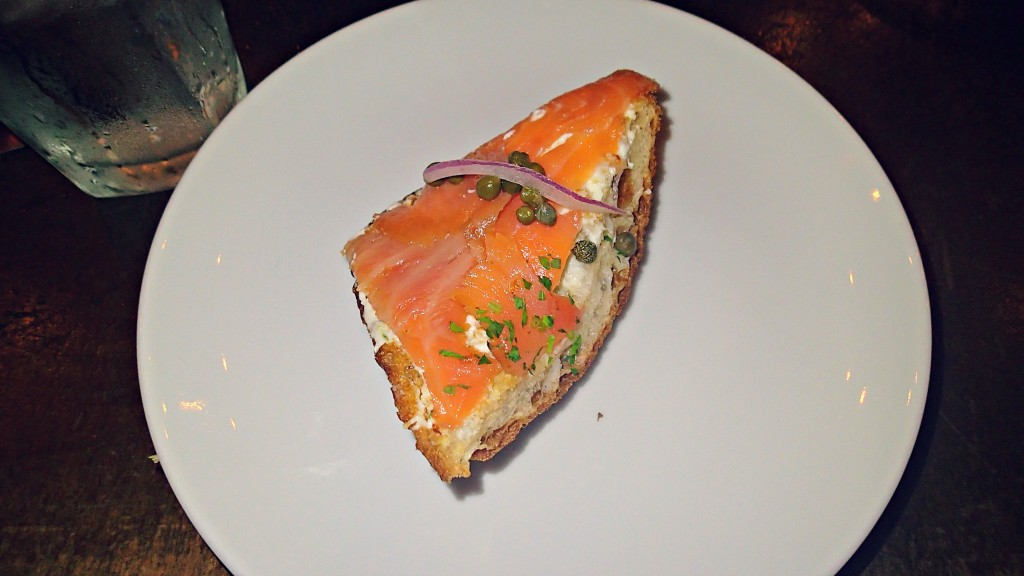 tabla de salmon smoked salmon, lemon-infused cream cheese, capers, red onion slices