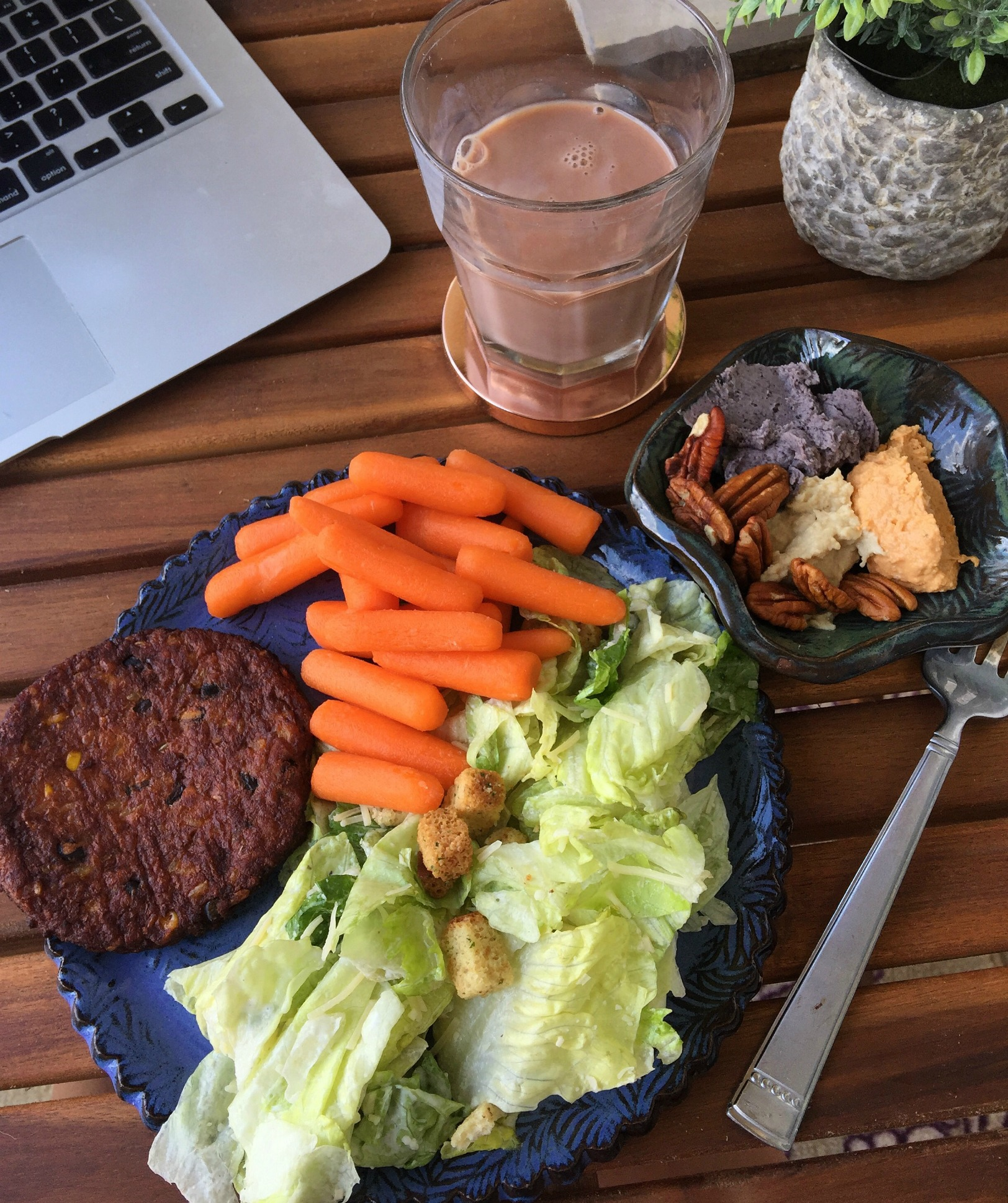 After my run, I made a side Caesar salad, spicy black bean burger and carrots and hummus. I also had a side of the boathouse farms protein juice.