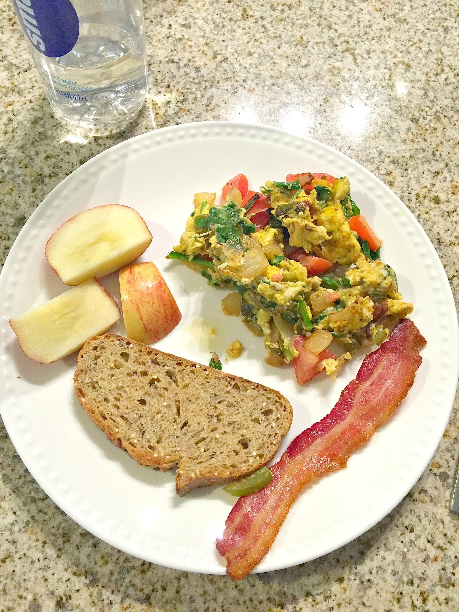 Perfect Breakfast: Whole Grain Toast, Apple Slices, Bacon & Veggie Egg Scramble.