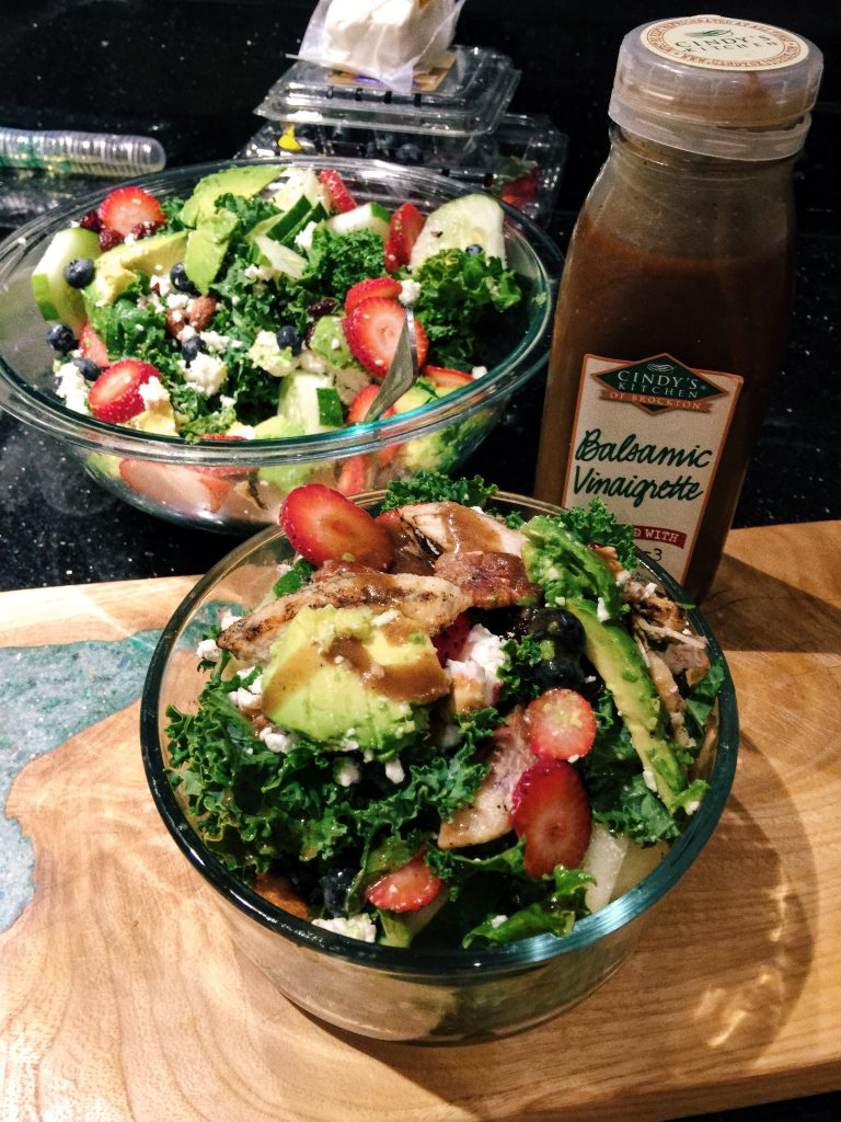Balsamic Kale Salad W/Berries, Grilled Chicken, Honey Roasted Mixed Nuts, Avocado, Goat Cheese, Dried Cranberries and Cucumber!
