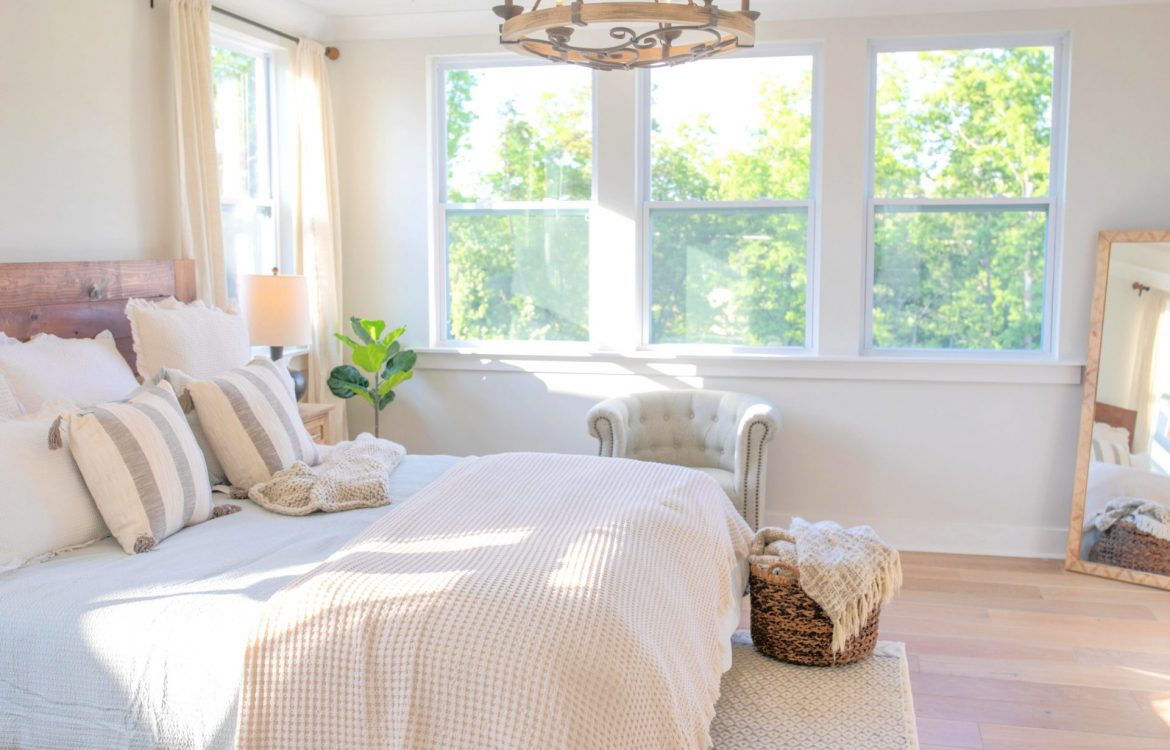 creamy bedroom, master bedroom, cottage, drapes, bedding, cozy bedroom, quilt, ivory bed, ivory quilt bedroom, master bedroom decor, neutral colors, target, HomeGoods, hobby lobby, bedding, hardwood floors, end tables, black curtain rods, linen drapes