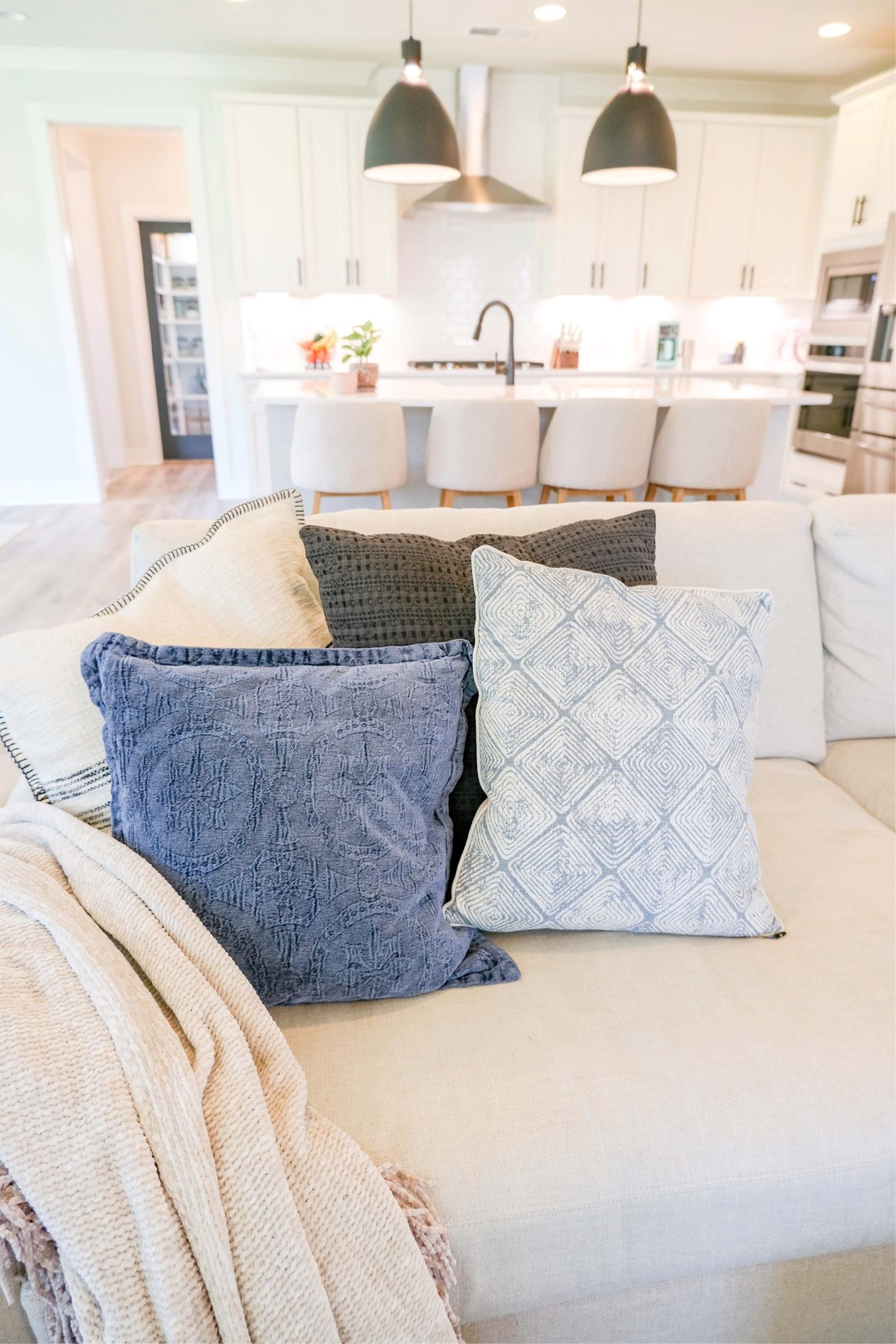 living room tour, target throw pillows, blue, black, arhaus, Remington sofas, my home, fielding homes, aura, plank cottage, white, board and button, home, outside, interior, fort mill, south Carolina, white kitchen, masons bend