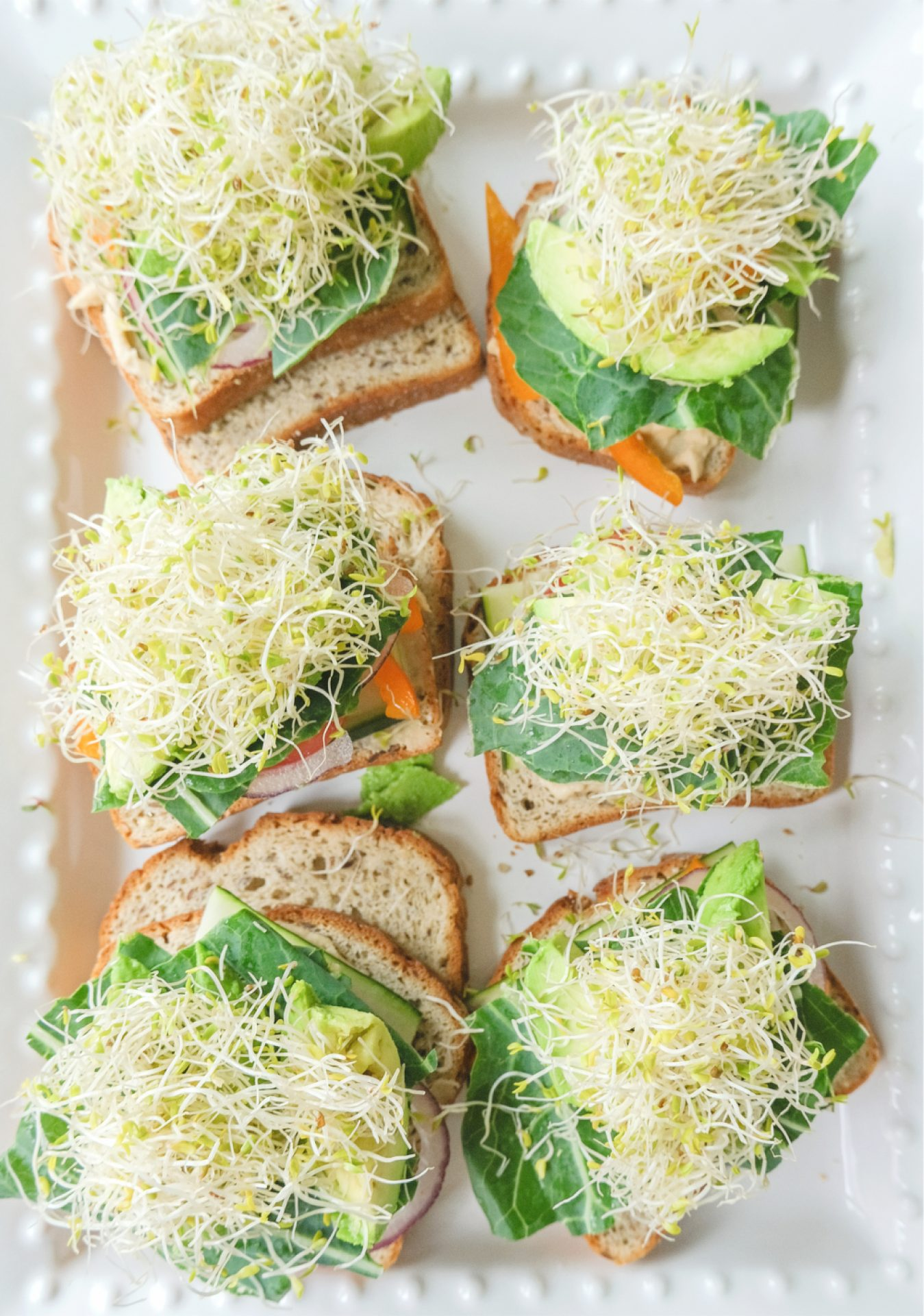 gluten free, plant based, sandwich, dairy free, lunch, vegetable sandwich, picnic, veggie sandwich, grapes, avocado, collard greens, hummus, veganaise, tomatoes, lunch idea, vegan, avocado, sprouts, cucumber, food, healthy eating, eat clean, veggie