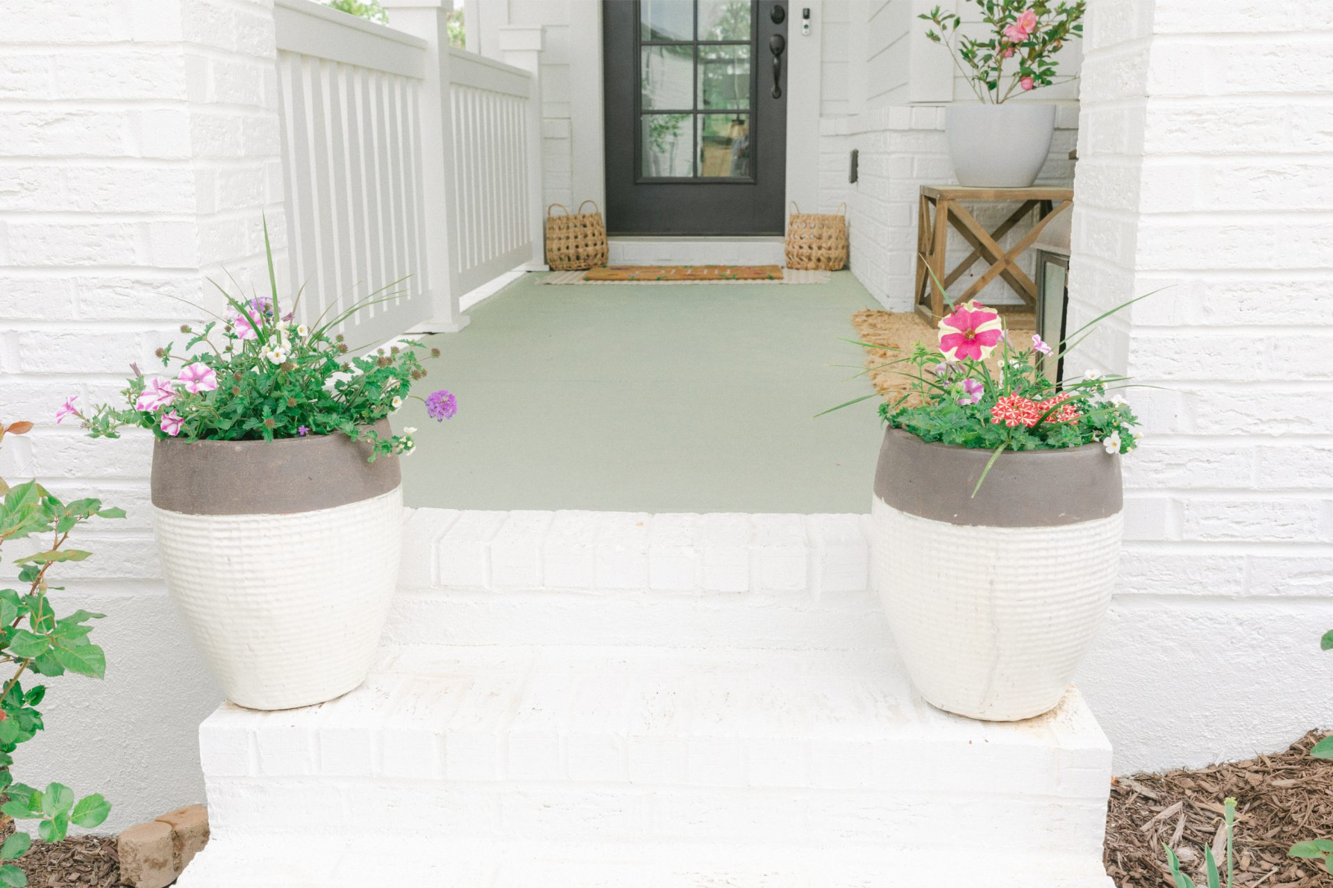 porch, painting porch, flowers, garden, tea leaf green, porch, front porch, kichler fan, light, flowers, cottage garden, couch, jute rug, roses, board and batten house, home decor